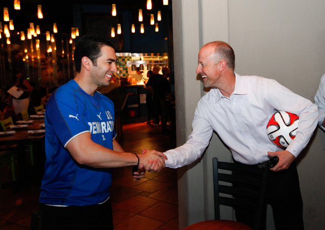 "State Sen. Ruben Kihuen, D-Las Vegas, left, greets Justin Findlay during Kihuen's ""Soccer with the Senator"" event for supporters featuring a watch party for the Mexico vs. Brazil World C ..."