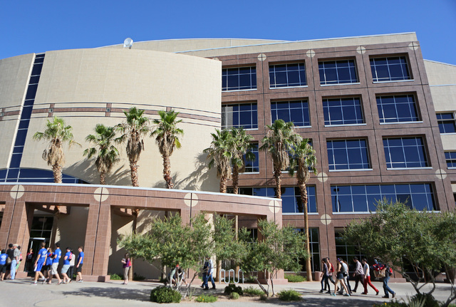 A Unification Church tour group walks up to Grant Sawyer Building Wednesday, June 25, 2014, in Las Vegas. The church group is part of God's Hope for America, a group of Reverend Sun Myung M ...