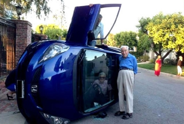 Elizabeth Neufeld, 85, and her husband, Benjamin, 87, of Bel Air, California, were caught in their Honda when it rolled over onto its side. Benjamin Neufeld was able to climb out of the passenger  ...