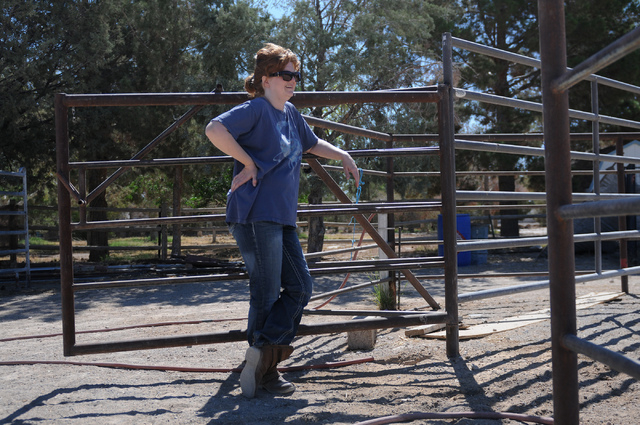 Denise DeLucia watches Robin Warren, 13, as she rides Chief, a 20-year-old appaloosa horse at a private ranch in Las Vegas Tuesday, June 24, 2014. Warren, with the help of her caregiver Denise DeL ...