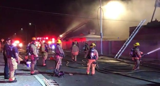 In a screen capture from video, Las Vegas and Clark County firefighters are shown battling a fire in a vacant house at 1701 E. St. Louis Ave. on Wednesday night. (Courtesy/YouTube, Las Vegas Fire  ...