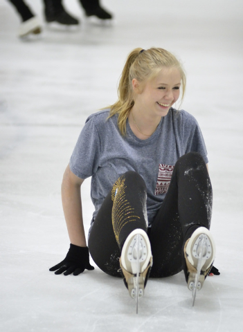 Skater Michelle Rudski comes up smiling after a spill while practicing at the Las Vegas Ice Center at 9295 W. Flamingo Road in Las Vegas on Thursday, May 29, 2014. The teenager suffered severe bur ...