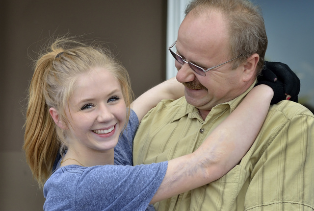 Skater Michelle Rudski is shown with her father Marek at the Las Vegas Ice Center at 9295 W. Flamingo Road in Las Vegas on Thursday, May 29, 2014. The teenager suffered severe burns last summer as ...