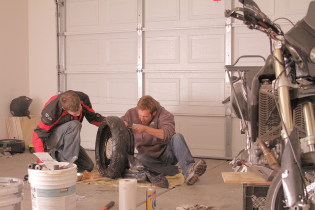 The documentarians fix a bike before leaving Vegas for the open road.