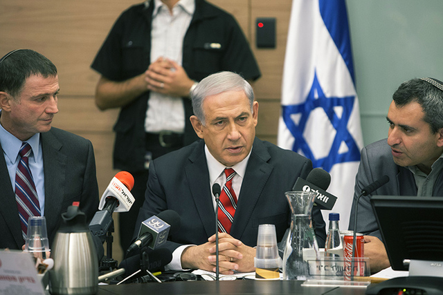 Israeli Prime Minister Benjamin Netanyahu speaks during a Foreign Affairs Committee meeting, at the Knesset, Israel's parliament in Jerusalem, Monday, June 30, 2014. At least 14 rockets launched f ...