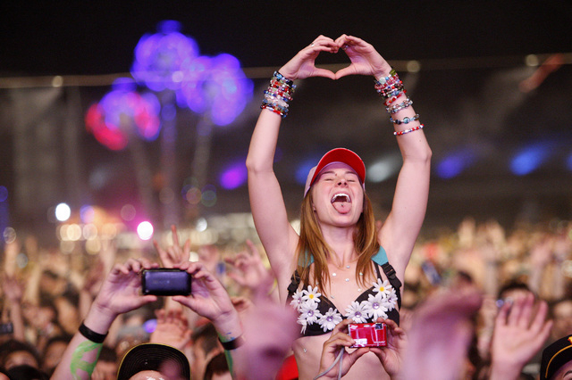 An attendee makes a heart sign while in the crowd during a set at the Electric Daisy Carnival at the Las Vegas Motor Speedway on Monday, June 27, 2011. (John Locher/Las Vegas Review-Journal)