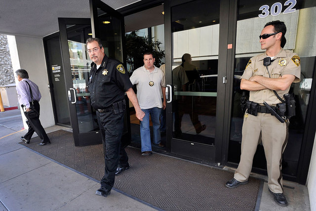 Las Vegas Constable John Bonaventura, left, leaves his downtown offices as Las Vegas police look on June 17, 2014. Bonaventura is under investigation by Metro detectives for conversations that wer ...