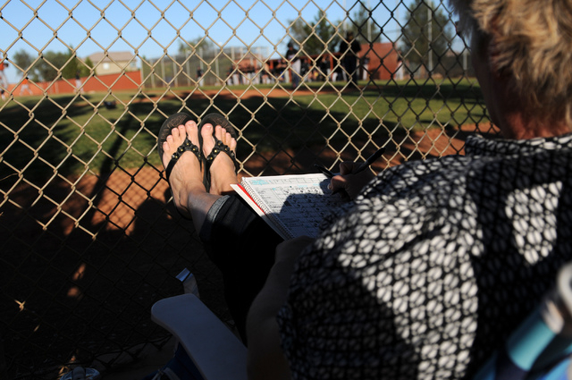 Laurie Oswald fills out a score sheet during a game between Durango Post 76 and Legacy during the opening week of the American Legion baseball season at Legacy High School in North Las Vegas on Sa ...