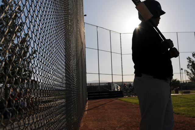 Durango Post 76 Johnathan Hernandez (27) watches his teammate at bat during their game against Legacy during the opening week of the American Legion baseball season at Legacy High School in North  ...