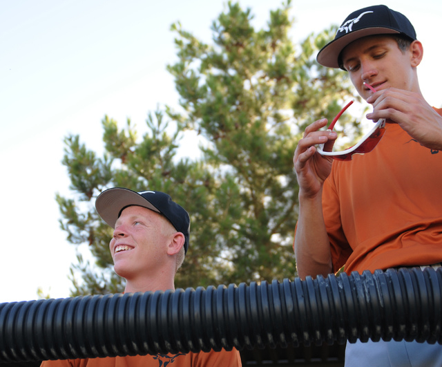 Legacy's Johnny Ball (23), left, and Anthony Golemme (37) watch their teammate at bat during their game against Durango Post 76 during the opening week of the American Legion baseball season at Le ...