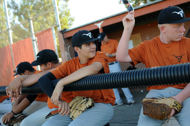 Legacy's Willie Valdez (34), left, and Johnny Ball (23), watch their teammate at bat during their game against Durango Post 76 during the opening week of the American Legion baseball season at Leg ...