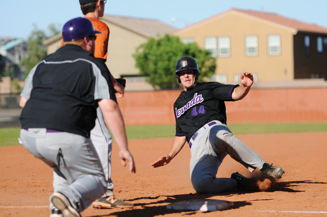 Durango Post 76 Jake Skipper (44) slides safely into third base during their game against Legacy during the opening week of the American Legion baseball season at Legacy High School in North Las V ...