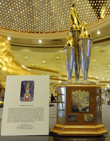 The Bill Masterton Memorial Trophy while on display in the lobby of the MGM Grand Hotel and Casino in Las Vegas Saturday, June 21, 2014. The trophy is awarded under the trusteeship of the Professi ...