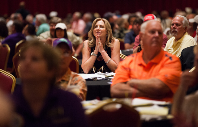 A woman watches as California Chrome falls behind in the Belmont Stakes horse race in Elmont, N.Y., during a viewing party at South Point hotel-casino in Las Vegas on Saturday, June 7, 2014. Calif ...