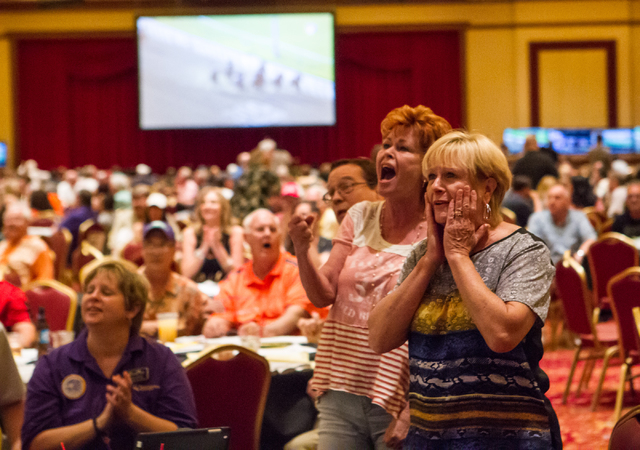 Linda McQuiggan, right, and Theresa McQuiggan react as California Chrome falls behind in the Belmont Stakes horse race in Elmont, N.Y., during a viewing party at South Point hotel-casino in Las Ve ...