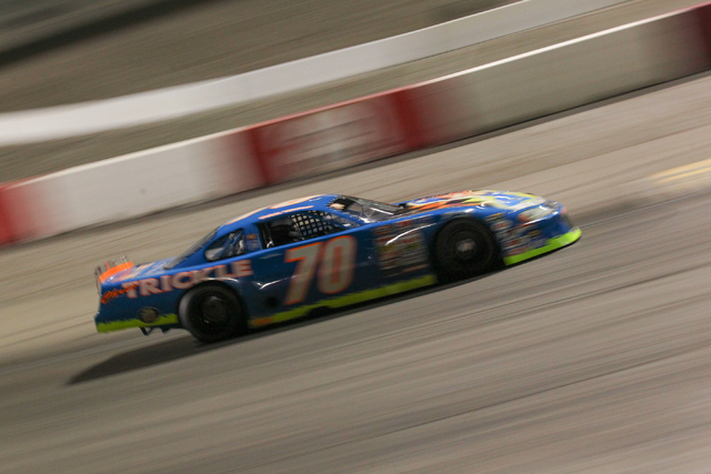 Chuck Trickle drives the NASCAR Super Late Model which his son, Chris Trickle, drove, during practice laps at the Bullring at Las Vegas Motor Speedway in Las Vegas on Friday, June 13, 2014. Trickl ...