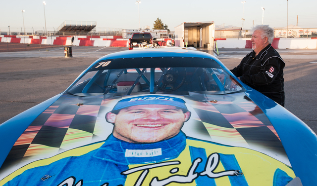 Chuck Trickle gets ready before driving the NASCAR Super Late Model which his son, Chris Trickle, drove, at the Bullring at Las Vegas Motor Speedway in Las Vegas on Friday, June 13, 2014. Trickle  ...