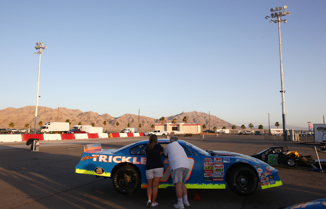 Chuck Trickle, right, talks with his wife Barbara, before driving the NASCAR Super Late Model which their son, Chris Trickle, drove, at the Bullring at Las Vegas Motor Speedway in Las Vegas on Fri ...