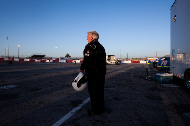 Chuck Trickle stands before driving the NASCAR Super Late Model which his son, Chris Trickle, drove, at the Bullring at Las Vegas Motor Speedway in Las Vegas on Friday, June 13, 2014. Trickle prac ...