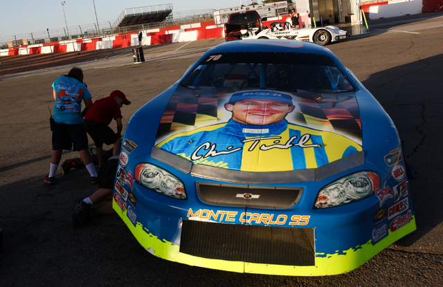 The NASCAR Super Late Model which Chris Trickle drove is worked on before being driven by Trickle's father, Chuck, at the Bullring at Las Vegas Motor Speedway in Las Vegas on Friday, June 13, 2014 ...