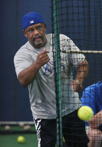 Bill Madlock, four-time Major League Baseball batting champion, throws pitches for a client during a private lesson at The Dugout indoor batting cages Thursday, June 19, 2014, in Las Vegas. In lig ...