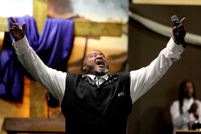 Deacon Richard Wallace speaks to the members right before the pastor comes out to preach at Kingdom Ministries in Las Vegas on Sunday, June 1, 2014. The small non-denominational church was started ...