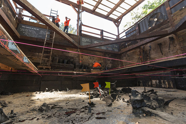 Excavators work at the bottom of the reactivated Pit 91 at Page Museum La Brea Tar Pits in Los Angeles, Thursday, June 19, 2014. A grid across the matrix helps paleontologists track where each bon ...