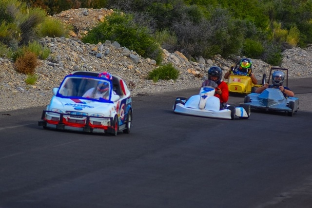 """Speeds at this race approached 60 mph. """"Bud Wiser"""" is followed by Jeffrey Hobbs, Aaron Freeman and Majinder Singh. (Courtesy Christopher Crews)"""