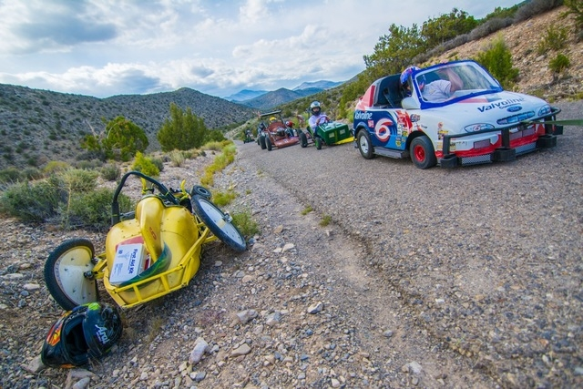 Drivers look on as they pass the wreckage of the crash on their way back to the top of the hill. (Courtesy Christopher Crews)