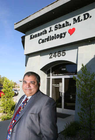 Dr. Kenneth Shah stands outside his practice, the Vascular Institute of Southern Nevada, Tuesday, May 13, 2014, in Henderson. Dr. Shah uses a low-risk laser atherectomy procedure to treat patients ...