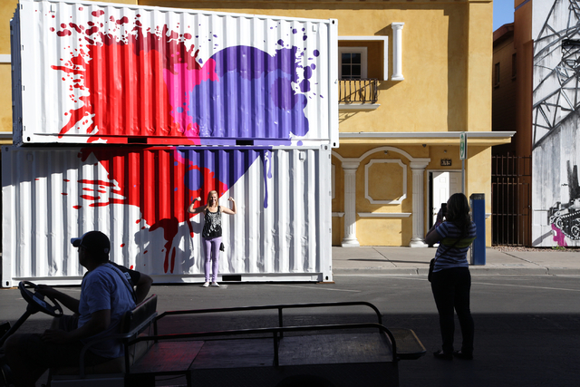 Visiting from Los Angeles, Cory Welsh poses while her friend, Chelsea Hartling, takes a picture in front of the Life Is Beautiful Festival logo in downtown Las Vegas on Friday, Oct. 25, 2013. The  ...