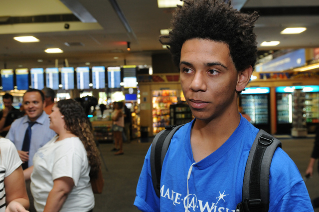 Tavori Lockhart, 17, whose Make-A-Wish was granted to go to the 2014 FIFA World Cup in Brazil, is interviewed as he waits for his flight with his parents at McCarran International Airport in Las V ...