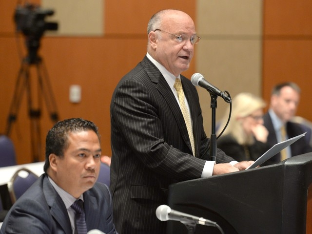 MGM Springfield President Mike Mathis, left, looks on as Massachusetts State Gaming Commission Chairman Steven Crosby gives his presentation during the second of several sessions deliberating the  ...