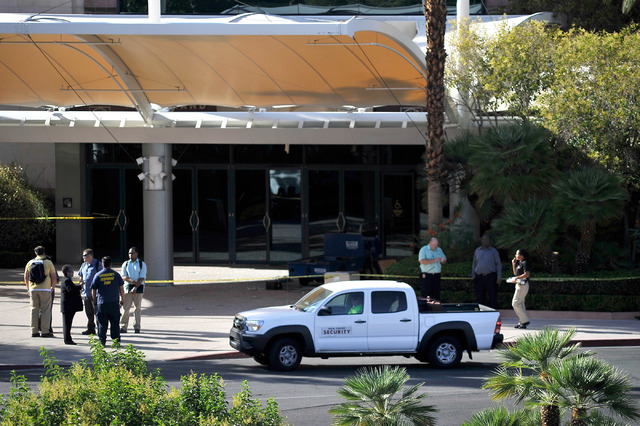 People stand in front of the MGM Grand Conference Center on Tuesday, June 10, 2014. An MGM employee died after an accident that resulted in a fall from the third floor. (David Becker/Las Vegas Rev ...