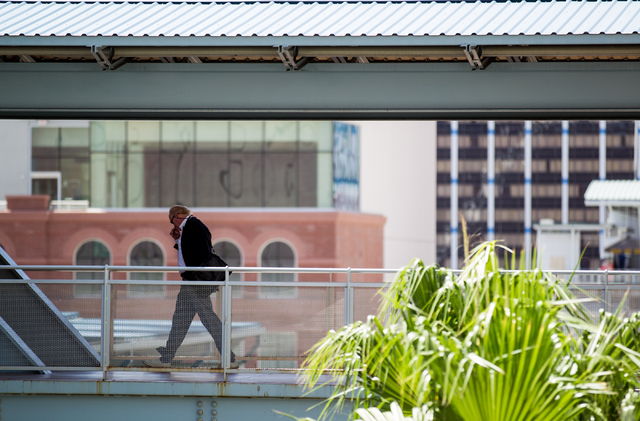 A man walks to the boarding area of the Harrah's/The Quad stop of the Las Vegas Monorail in Las Vegas on Monday, May 19, 2014. (Chase Stevens/Las Vegas Review-Journal)