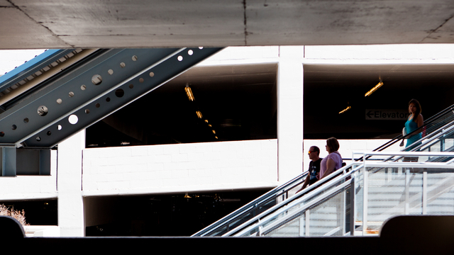 Passengers take the escalator down at the Harrah's/The Quad stop of the Las Vegas Monorail in Las Vegas on Monday, May 19, 2014. (Chase Stevens/Las Vegas Review-Journal)