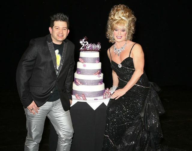 """Frank Marino, right, shown in character as star and producer of """"Divas Las Vegas"""" at The Quad, and his fiance, Alex Schechter, hold the cake to mark Marino's 25,000th performance on the Strip. He  ..."""