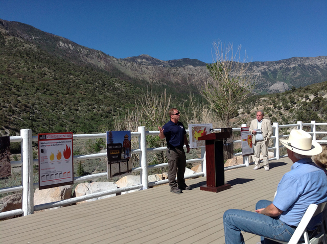 Mike Haydon, Bureau of Land Management southern Nevada district fire management officer, speaks about the need for proactive fire prevention by people Tuesday, June 24, 2014, at the Mount Charlest ...