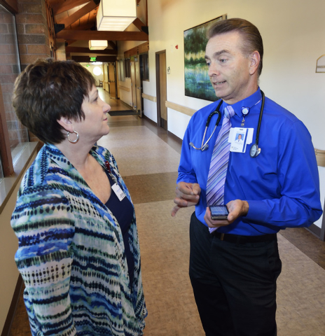 Dr. Michael Karagiozis, medical director for Nathan Adelson Hospice, right, talks with nurse Pamela Cate at the hospice at 4131 Swenson St. in Las Vegas on Friday, June 6, 2014. (Bill Hughes/Las V ...