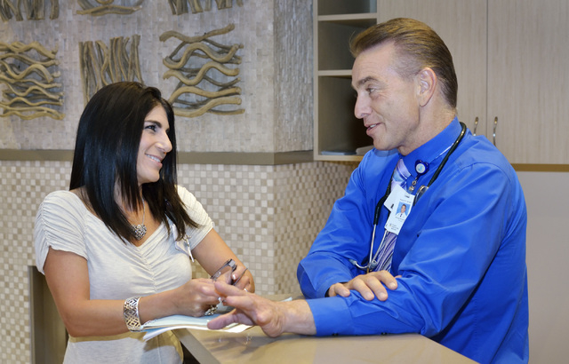 Dr. Michael Karagiozis, medical director for Nathan Adelson Hospice, right, talks with social work supervisor Susan Shapiro at the hospice at 4131 Swenson St. in Las Vegas on Friday, June 6, 2014. ...