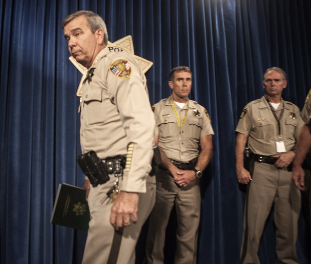Clark County Sheriff Doug Gillepie exit after a press conference about the deaths of officers at Metro Police Department on Monday, June , 2014. Officers Alyn Beck, 41, and Igor Soldo, 31, were ea ...