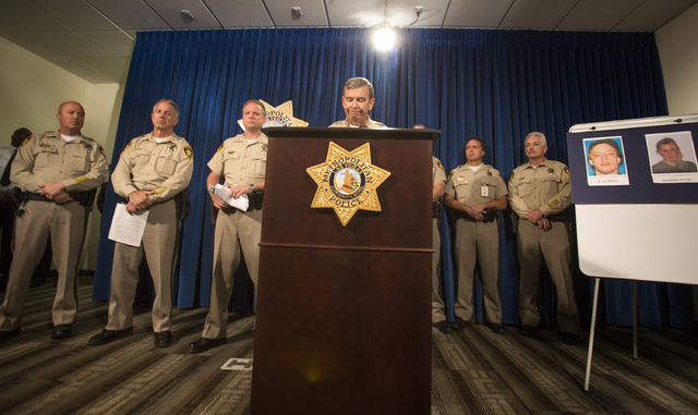 Clark County Sheriff Doug Gillespie addresses the media during a press conference at Metro Police Department on Monday, June , 2014. On the right are photos of the suspects Jerad and Amanda Miller ...