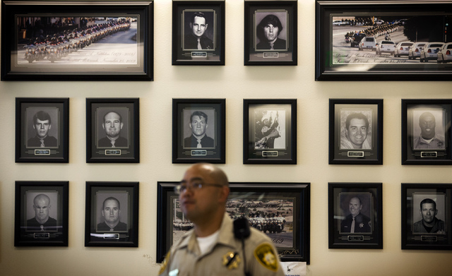 Metro officer Dave DeLeon stands near the officer memorial wall at Metro Police Department on Monday, June , 2014. Officers Alyn Beck, 41, and Igor Soldo, 31, were eating at CiCi's Pizza Sunday wh ...
