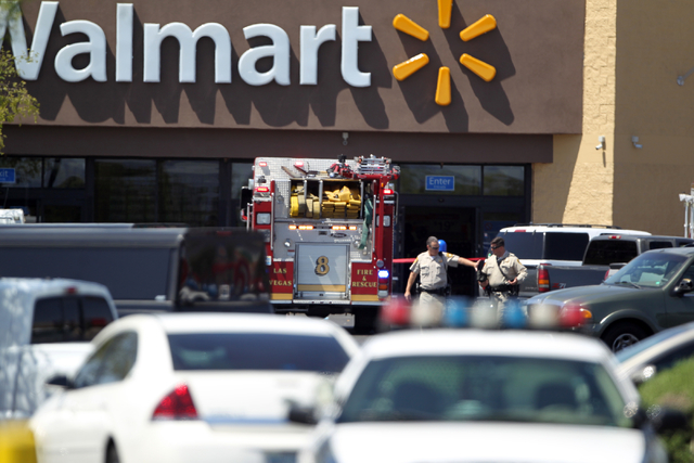 Las Vegas police and firefighters appear outside a Walmart after shootings left five people dead -- including two Las Vegas police officers -- at the store and a nearby CiCiճ Pizza at the co ...