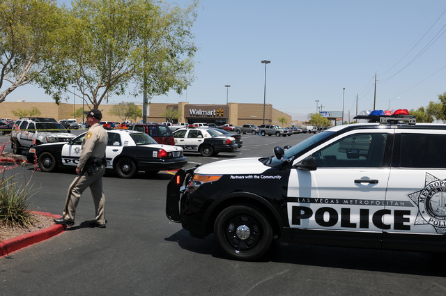 The scene at Walmart near Nellis Boulevard and Stewart Avenue where two suspects are confirmed to have shot two police officers Sunday, June 8, 2014. (Erik Verduzco/Las Vegas Review-Journal)