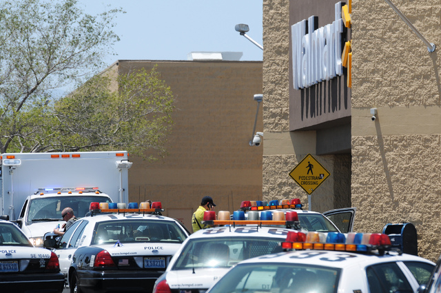 The scene at Walmart near Nellis Boulevard and Stewart Avenue where two suspects were killed after they shoot and killed two Metro police officers on Sunday, June 8, 2014. (Erik Verduzco/Las Vegas ...