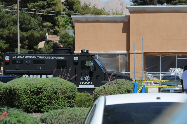 The scene at Walmart near Nellis Boulevard and Stewart Avenue where two shooting suspects are confirmed deceased after shooting two police officers Sunday, June 8, 2014. The medical conditions of  ...