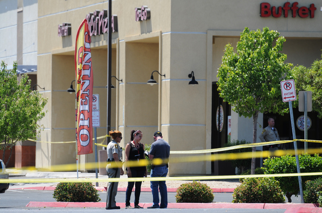 The scene at Cici's Pizza near Nellis Boulevard and Stewart Avenue where two suspects shot two police officers Sunday, June 8, 2014. (Erik Verduzco/Las Vegas Review-Journal)