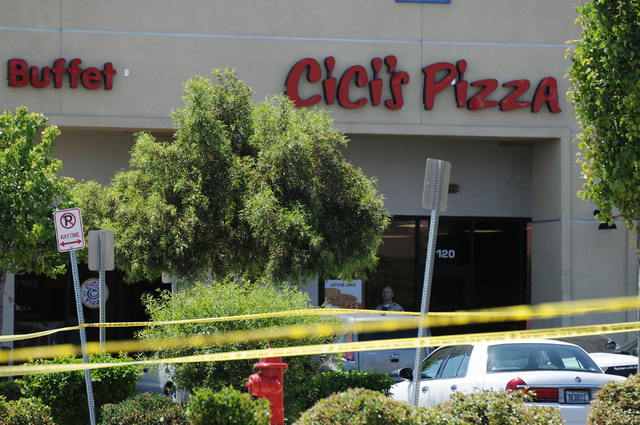 The scene at Cici's Pizza near Nellis Boulevard and Stewart Avenue where two suspects shot two police officers Sunday, June 8, 2014. The medical conditions of the two police officers have not been ...