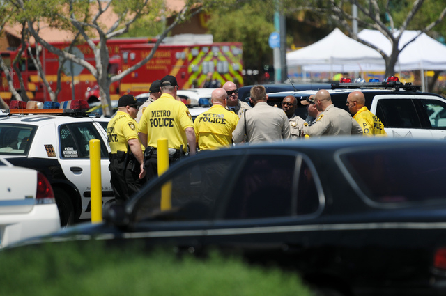 The scene at Walmart near Nellis Boulevard and Stewart Avenue where two shooting suspects are confirmed deceased after shooting two police officers Sunday, June 8, 2014. (Erik Verduzco/Las Vegas R ...